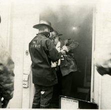 Image of 0120-006_01-09-005 - Fireman W.C. Purvis and Others in Burning Building