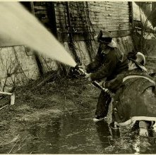 Image of 0120-006_01-09-009 - Two Firemen Using Fire Hose