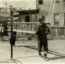 Image of 0120-006_01-09-012 - Firemen Carrying Ladder