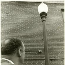 Image of 0120-006_01-13-004 - Mayor John C. Lewis Looking at Lightpost