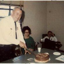Image of 0120-006_01-19-006 - Police Chief Leo B. Ryan Cutting Cake
