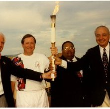 Image of 0123-045_08-22-016 - John Rousakis, Floyd Adams, Jr., and Others with Olympic Torch