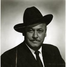 Image of 1121-100_0031 - Man in a Black Suit and Black Hat.