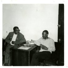 Image of 1121-100_0532 - Two men sitting at a table