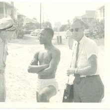 Image of 1121-100_0940 - Young Man with Police Officer at the Beach