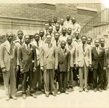 Image of 1121-100_0003 - Group of Men in front of a Building