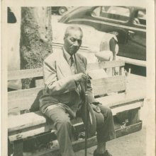 Image of 1121-100_1542 - Man Sitting on a Bench