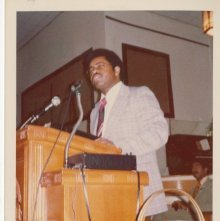 Image of 1121-100_1580 - Man speaking from a pulpit