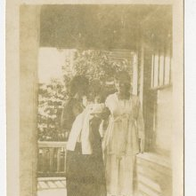 Image of 1121-100_1639 - Two Women on a Porch with a Baby