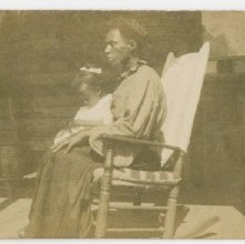 Image of 1121-100_1646 - Woman Sitting on a Rocking Chair