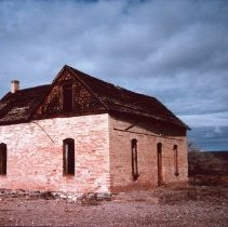 Image of Built by Dudley Leavitt Jr. - Picture of old house across from falls in Bunkerville.  Built by Dudley Leavitt Jr. about 1898 bricks made by the Fobbin brothers property and home belongs to Venna Davis of Las Vegas, Nv.