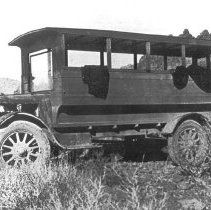 Image of School Bus - 1920 (Old Henry) - Picture of School Bus - 1920 (Old Henry) bus body built by Mesquite men, Lew Pulsipher and Vie Hancock, on a truck chassis - to take children 5 miles to Bunkerville from Mesquite for school. Bus Drivers were Vie Hancock and Henry Fordham.
