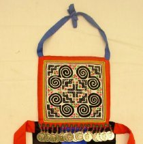 Image of Cher Moua Thao, Child's front apron, 1985, Hmong