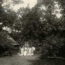 Image of Family Group in front of Tent Cottage - pc-6-2-1-a-m