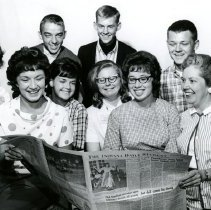 Image of CHS - Students and teachers around newspaper