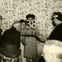 Image of Annual PC Dinner - Blowing out Candles - pc-6-11-1-c-m