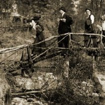 Image of Hikes and Walks - Hikers Crossing Rustic Bridge in Palos - pc-6-7-2-b-m