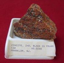 Image of ZINCITE, ZnO, BLACK IS FRANKLINITE, ALSO - Mineral