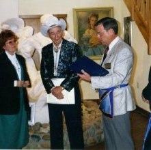 Image of Roy Rogers receives 50 year award from Bill Bray, Inspector. 1997