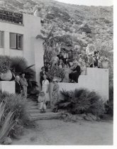 Image of Pink mansion, many people on steps c.1930 - 15-112