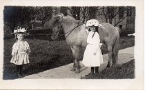 Image of 2 Young girls with pony