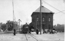 Image of Postcard - C. & N.W. Depot and train on DeKalb Avenue