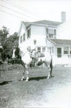 Image of A young boy on a pony at the Engh Farm - Photograph