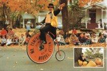 Image of Postcard - Mr. Pumpkin rides his high-wheeler bicycle in parade