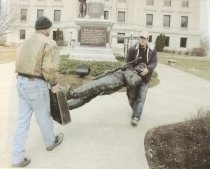 Image of Moving a statue of a civil war soldier to the front of the courhouse - Photograph, Color