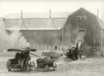 Image of Farm crop being harvested and stored in a barn by steam engines - Photograph, Black-and-White