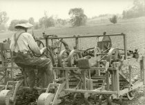 Image of Farm field being tilled by a machine - Photograph, Black-and-White