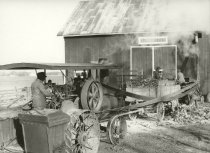 Image of Farm crop being harvested and stored and powered by a steam engine - Photograph, Black-and-White