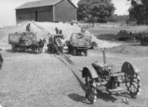 Image of Farm crop being harvested and stored in a stack - Photograph, Black-and-White
