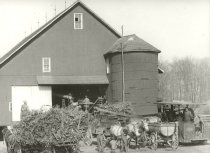 Image of Farm crop being harvested and stored in a barn - Photograph, Black-and-White