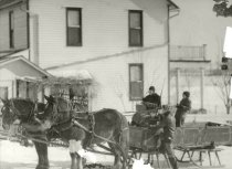 Image of Family in a sleigh wagon pulled by two horses - Photograph, Black-and-White