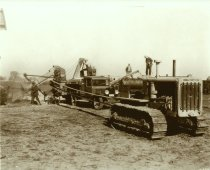 Image of Caterpillar tractor, old truck and threshing machine harvesting a farm crop - Photograph, Black-and-White