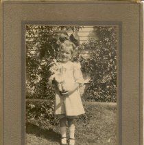 Image of Photo of Bernice Gould (?) as a young child, holding a doll