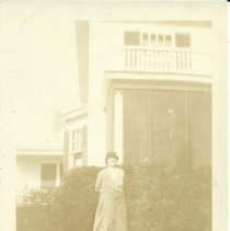"Image of photo of Eleanor ""Nellie"" Fletcher outside 62 Main Street"