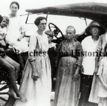 """Image of Hinton C. Peeler Family & Jack Taylor Family with Model T - Probably Neptune Beach, Florida  The Hinton C. Peeler family and Clyde """"Jack"""" Taylor family in front of Model T Ford."""