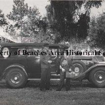Image of Mr. & Mrs. Clyde Davis leaving for 1966 Gildden Tour - Mr. & Mrs. Clyde Davis in front of old car when leaving for 1966 Gildden Tour. October 20, 1966.  **See also: Beaches Leader, Thursday, April 3, 1975