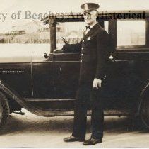 Image of Willis Charles Streeter, Jacksonville Beach Police Chief, 1927 - 1931 - Jacksonville Beach, FL Willis Charles Streeter, Police Chief of Jacksonville Beach from 1927-1931 in uniform standing beside his car on the beach.  Beach houses in background.