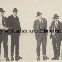 Image of Friends with a shark - Pablo Beach, Florida  -  On the Beach -   March 1921  Left to right:    E. J. George ( holding dead shark),  M. Thurber, J. U. Perry &  George E. Newton  pointing a  gun at  a dead  shark..