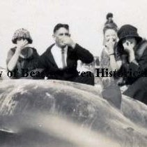 Image of People on the beach with Washed -up Whale - Pablo Beach, Florida  -    June 23, 1919 Ernest Peck Porter posing with ladies holding their noses next to a dead whale on the beach.