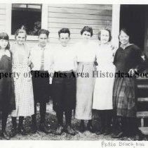 """Image of Pablo School 8th grade class - Pablo School , 8th grade graduating class. Left to right: Mary Shad, Marion Jeffers (Mrs. Earl Kirkpatrick), Richard Ivory, Edward Wright McCormick, Mrs. Charles Williams (teacher) , Erie Smith and Alma Louise (""""Happy"""") Gonzales."""