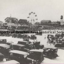 Image of Boardwalk - Jacksonville Beach, Florida  Boardwalk showing ferris wheel, cars on the beach, water tower, skee ball bowling, Greystone Grill and Sandpiper Bath House