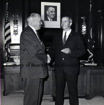Image of Jerome J. Keating Congratulates E. Vann Kirkpatrick on Winning Carnegie Medal for Heroism - Jerome J. Keating, President, National Association of Letter Carriers, congratulates E. Vann Kirkpatrick, letter carrier from Jacksonville Beach, FL  and former lifeguard, who was awarded the Carnegie Medal for heroism, The Red Cross Certificate of Merit and the Post Office Dept.'s Superior Accomplishment Certificate for saving the lives of three children in 1963.