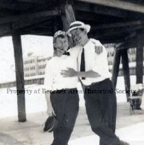 Image of John Humphries & friend - Atlantic Beach, Florida ( no date) John Humphries and friend at Atlantic Beach Pier with the Continental Hotel in background.