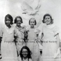 Image of Girls posing by baby Linbergh