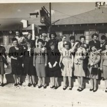 Image of Faculty: Grammar School #50 - Jacksonville Beach, Florida January 11, 1946 Faculty: School #50: in front of Davis Sea Shell, 15th Ave N. & Ocean Front 19 female teachers, many with hats and gloves, peep-toe shoes, suits, a few dresses,varied ages:Top row: Falconer, Clerk; Wood, 6; Lee 1; Nison, 1; Delvin, 5; Brandies, 5; Richardson, 4;Mitchell, 2; Johnson, 3; Bottom Row: Martin, 6; Hartsuff , 2,: Chambers, Principal; Brown 1, Lester, 6, Hills, 4; Warlick 6, Matthews 3; Hauser,