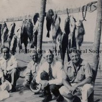 Image of Penman with three other and fish catch on pier - Jacksonville Beach, Florida